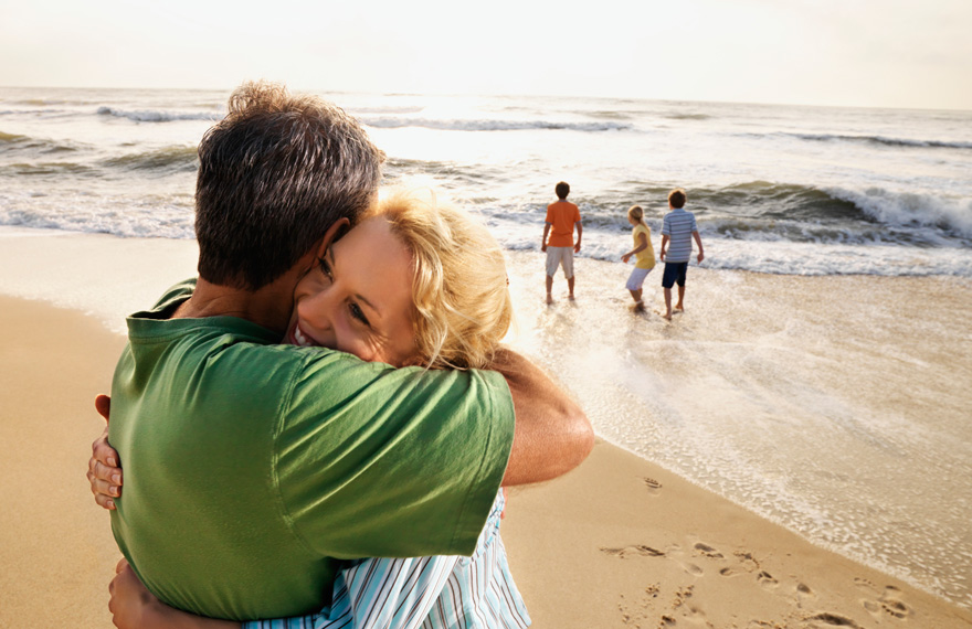 Mother and Adult son Hug on beach
