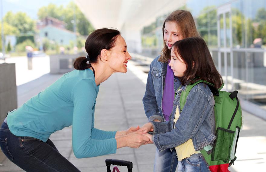 Mother saying farewell to kids