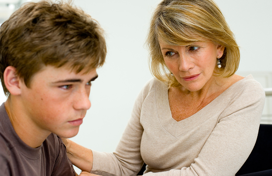 Woman talking to young man, concerned