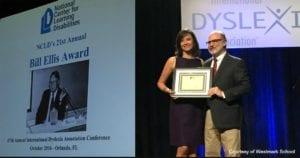 Dr. Sheldon Horowitz presents Claudia Koochek with the Bill Ellis Award
