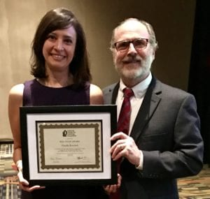 Dr. Sheldon Horowitz presents Bill Ellis Award to Claudia Koochek
